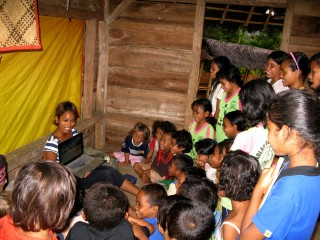 Nila teaching local children